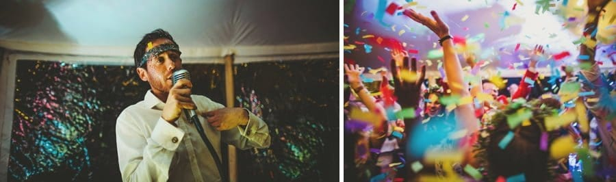 A wedding guest sings a song and a confetti canon is fired into the air inside the marquee