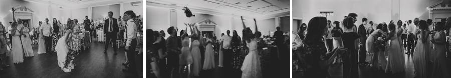 The bride throws her flower bouquet across the dance floor towards her bridesmaids