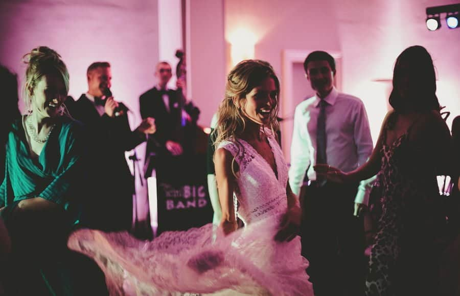 The bride dancing in front of her wedding guests