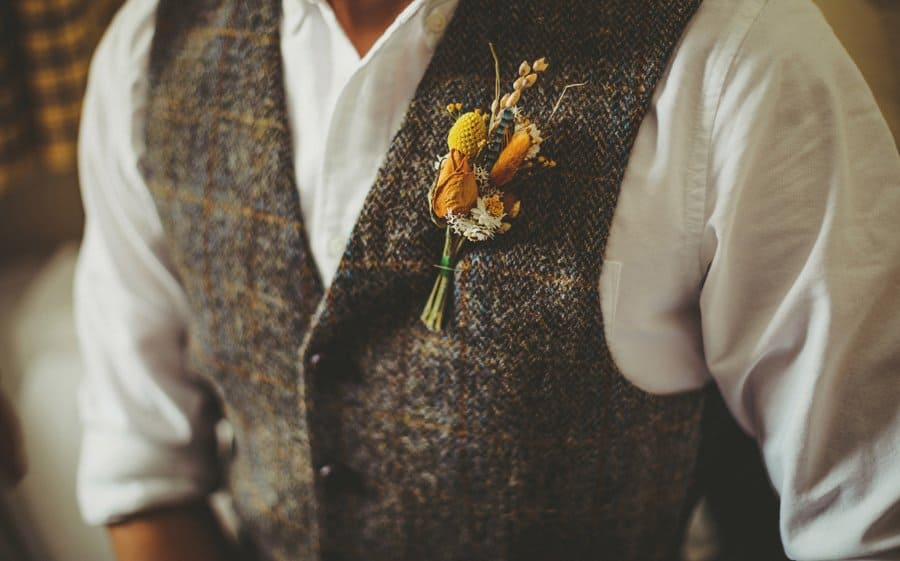 The grooms flower on his lapel