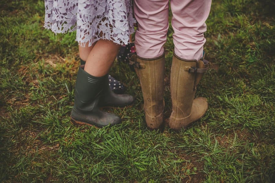Wedding guests stood in the field with their wellington boots on