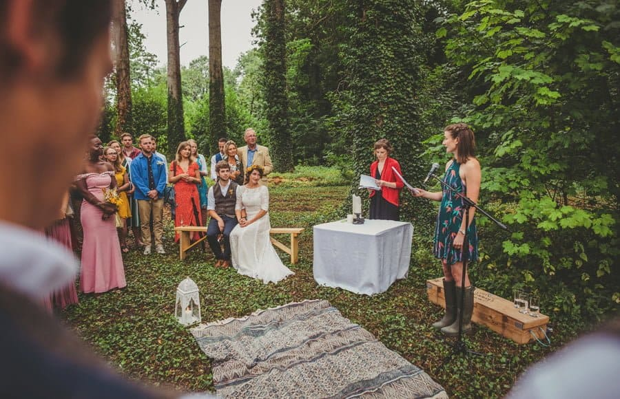 A wedding guest reads a poem to the bride and groom