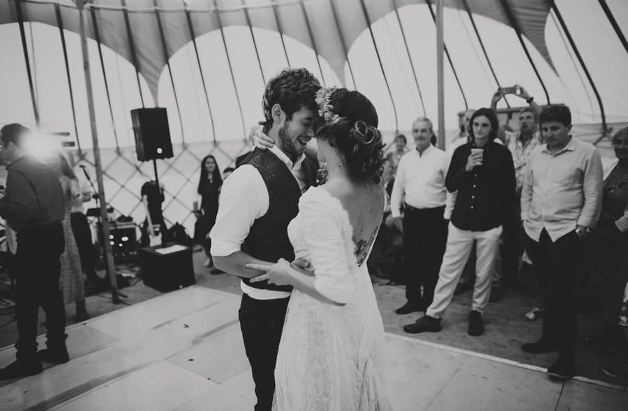 The bride and groom celebrate their first dance in the yurt at Hexton school