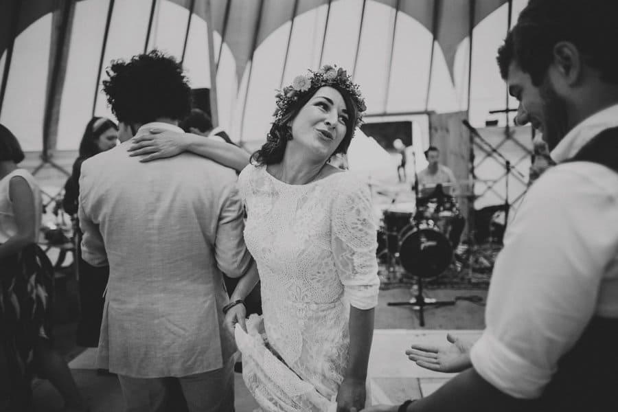 The bride dances in the yurt with friends and family