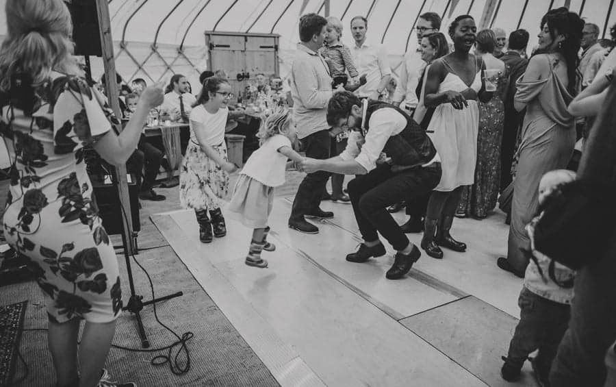 The groom dances with his niece on the dance floor