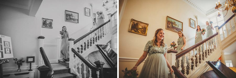 The bridesmaids walking down the main staircase at Barley Wood house