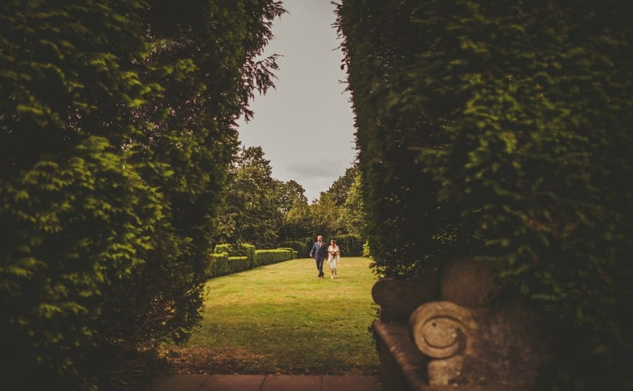 The bride and her father walking along the back lawn at Barley Wood house