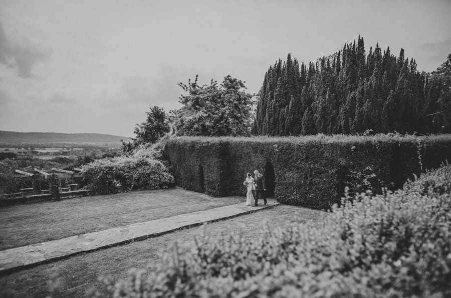The bride and her father walking towards the outdoor ceremony at Barley Wood house