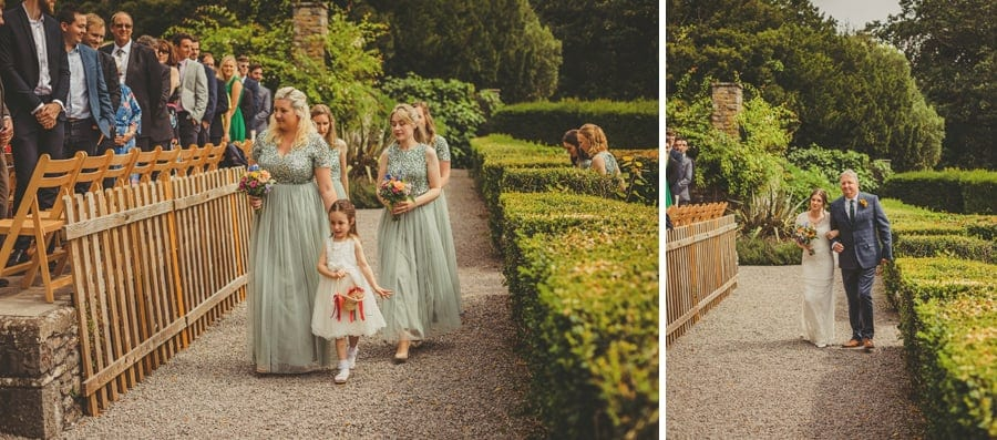 The bridesmaids, flower girl, the bride and her father arrive at the outdoor ceremony at Barley Wood house