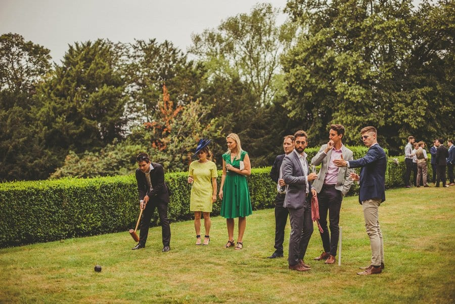 Wedding guests playing croquet on the lawn at Barley Wood house
