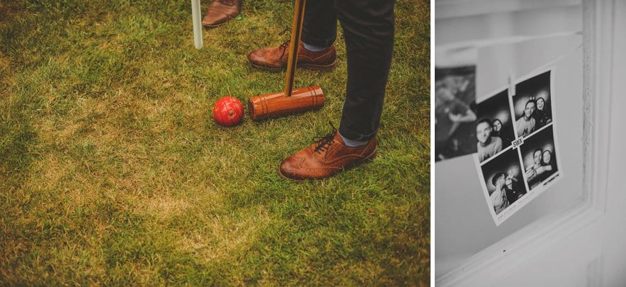 A man stands over a red croquet ball and attempts to hit it and a black and white photograph hangs from a ribbon
