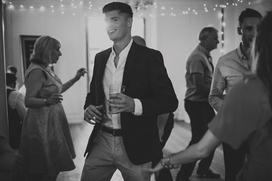 A wedding guest dancing on the dance floor