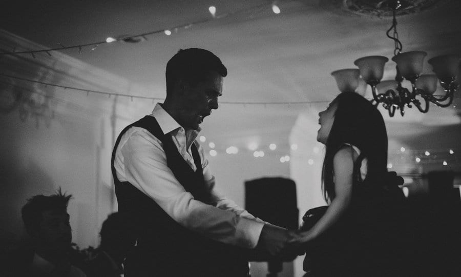 The groom dancing with a family member on the dance floor