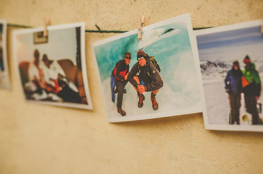 Photographs hang from a piece of string