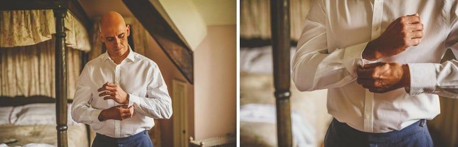 The groom fastens his cufflinks