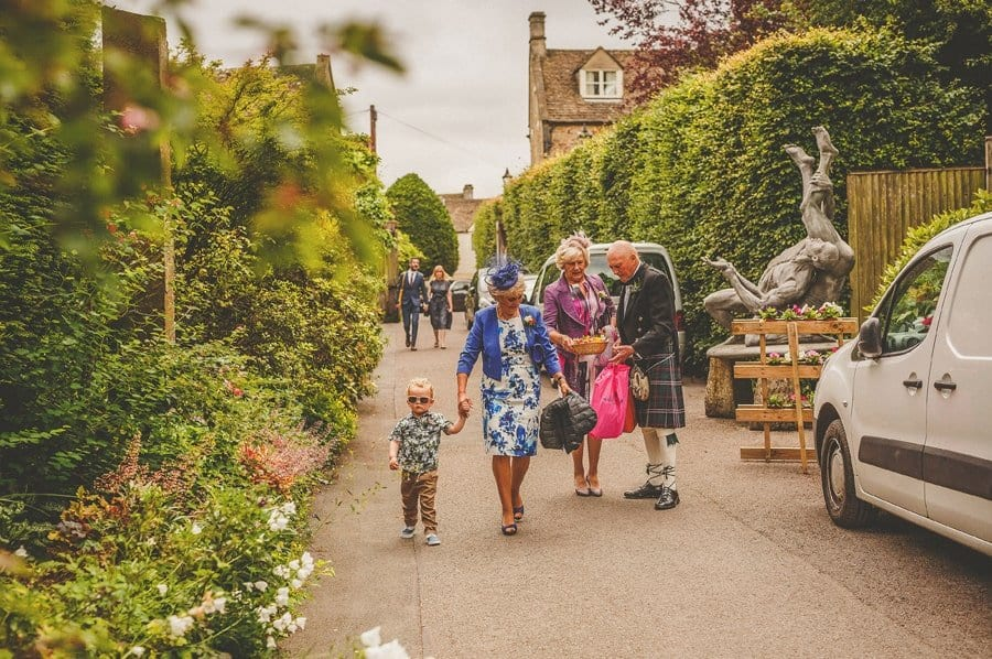The groom's family arrive at Abbey House gardens