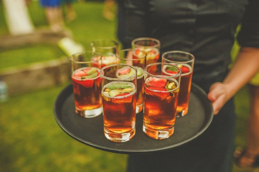 Drinks are served on a tray in the gardens