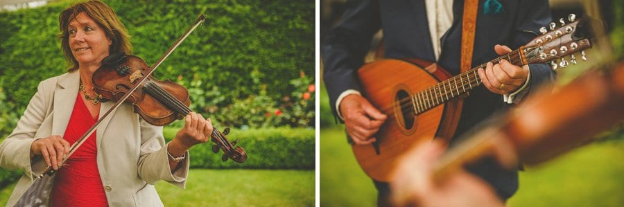 A lady plays violin and the brides father plays guitar