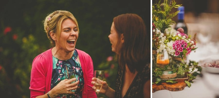 A lady laughs with her friend in the gardens at Abbey House