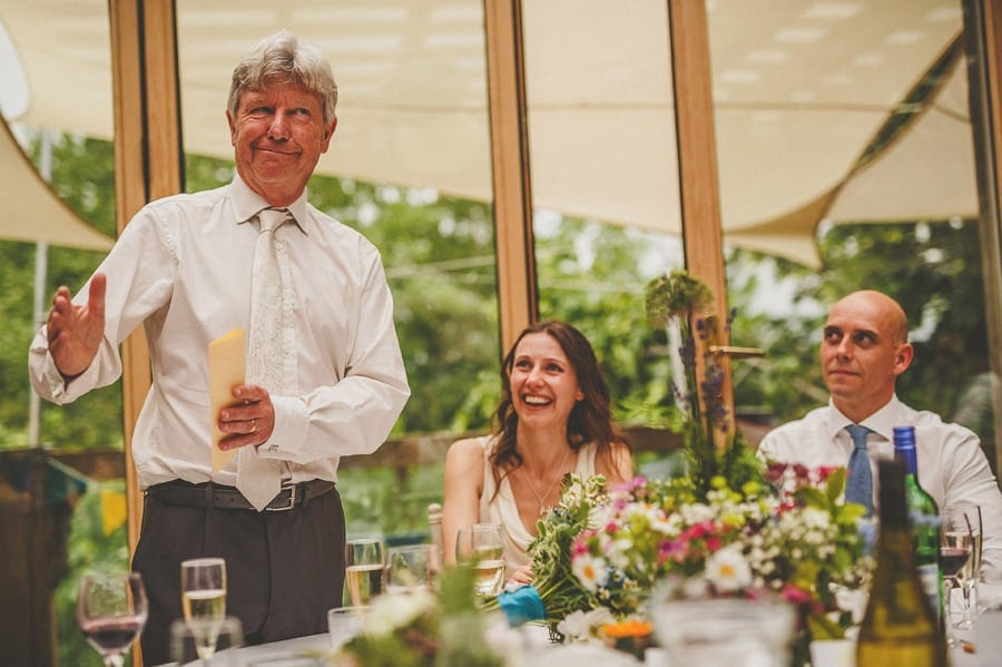 The brides father stands up and delivers his speech