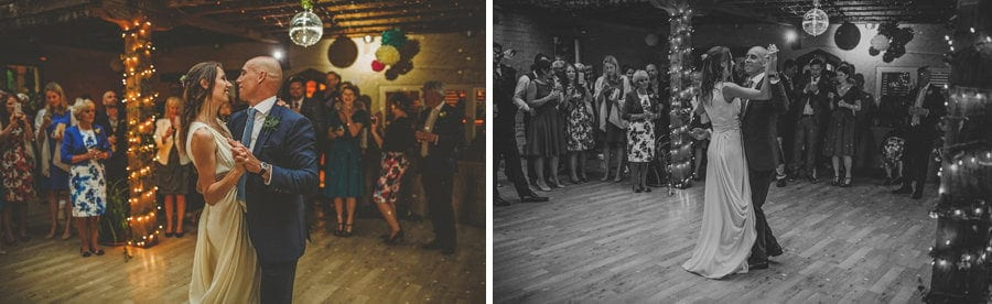 The bride and groom dance together on the dancefloor