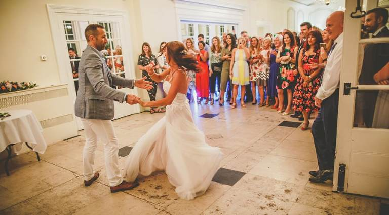 The bride and groom dance as husband and wife at a wedding venue in Clifton, Bristol