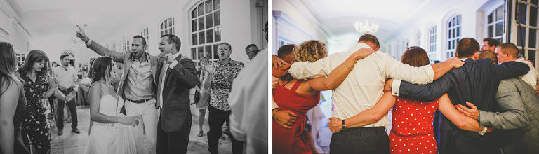 Wedding guests embrace each other on the dancefloor in Clifton, Bristol