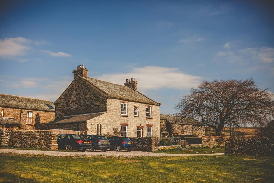 A cottage in Kirkby Stephen with cars parked outside