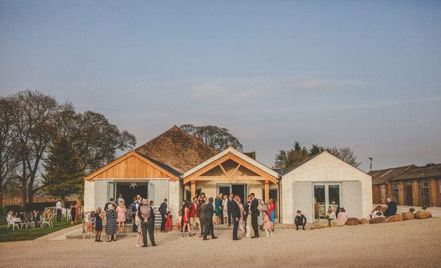 Wedding guests outside Eden Barn in Little Musgrave, Cumbria