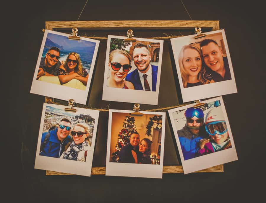 Polaroid prints on a wooden frame of the bride and groom