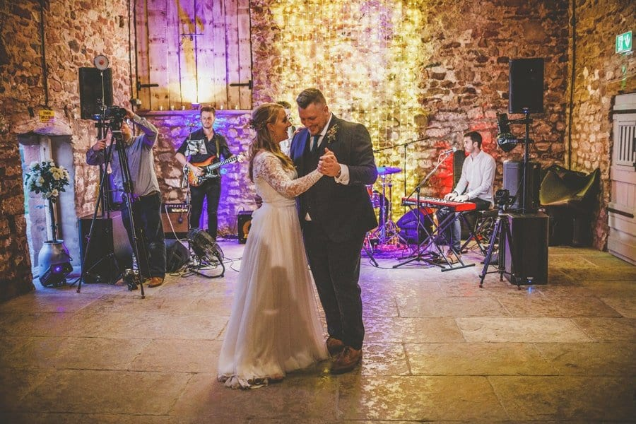 The bride and groom's first dance in the barn