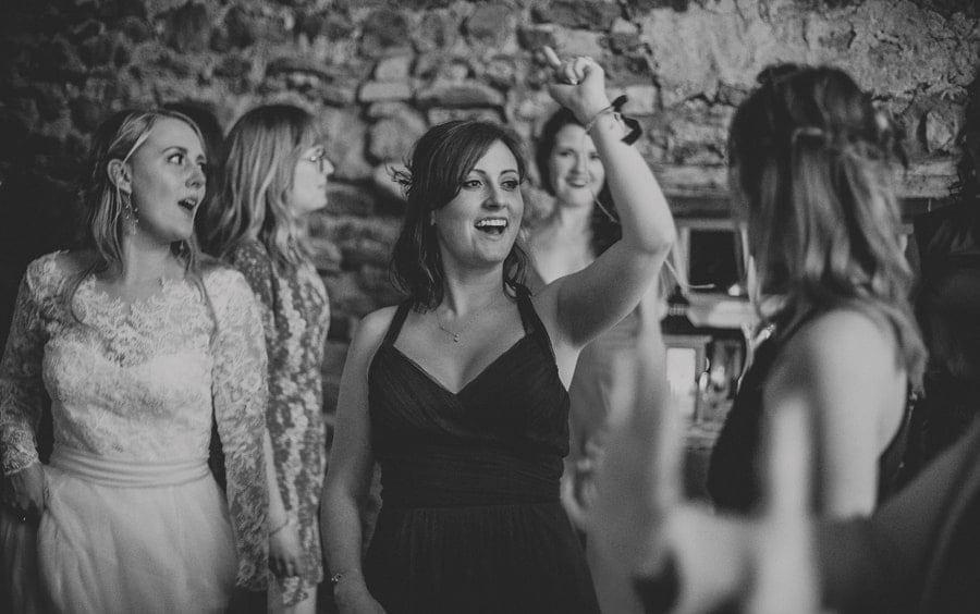 A bridesmaid dancing on the dancefloor in Eden Barn