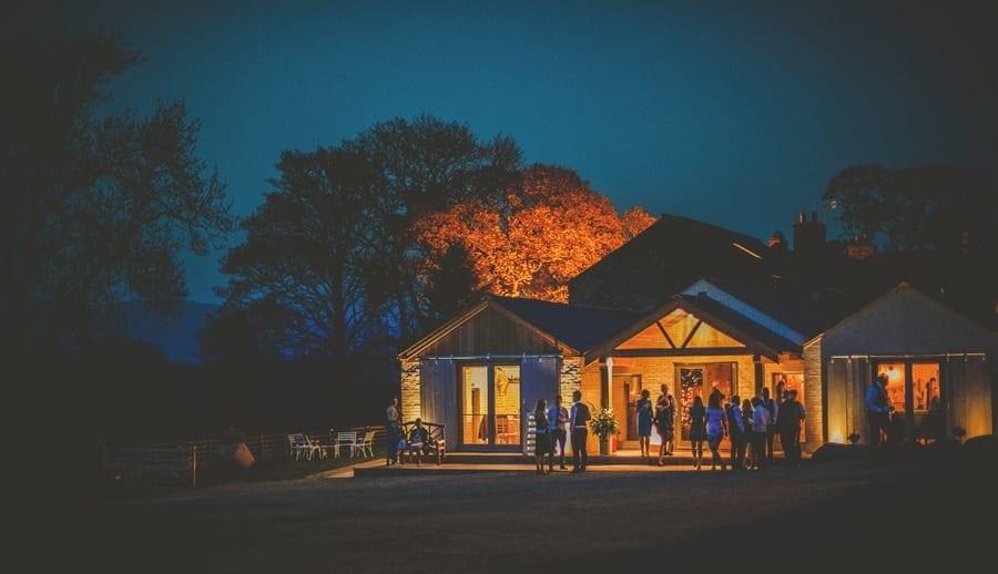 Wedding guests outside Eden Barn in Little Musgrave