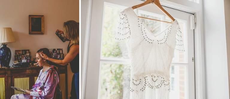 The wedding dress hangs from a window ledge