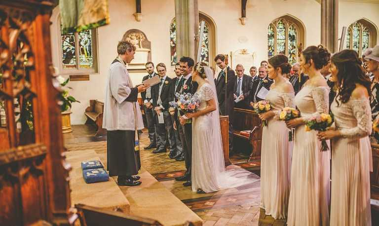 The vicar greets the bride and groom