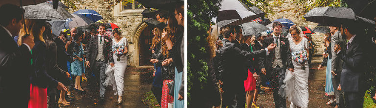 Wedding guests hold umbrellas and throw confetti at the bride and groom outside the Church