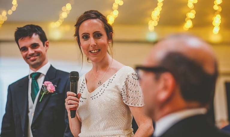 The bride delivers her speech to the wedding party