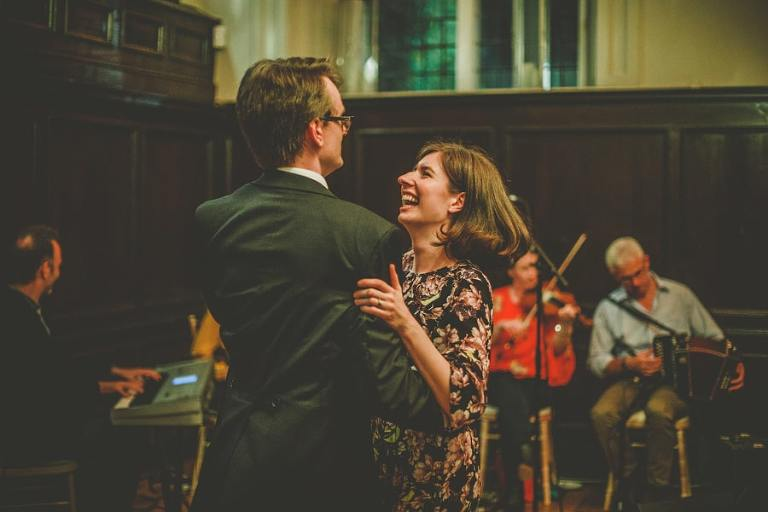 A man dances with his wife on the dancefloor at Fulham Palace