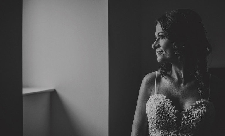 The bride looks out of her flat window