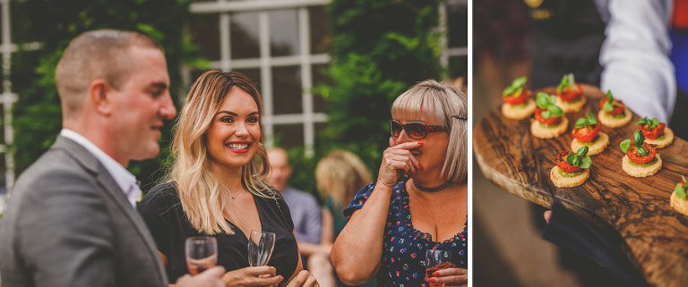 Wedding guests drink champagne and eat canapes