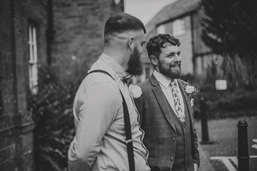 The groom and his best man share a joke together