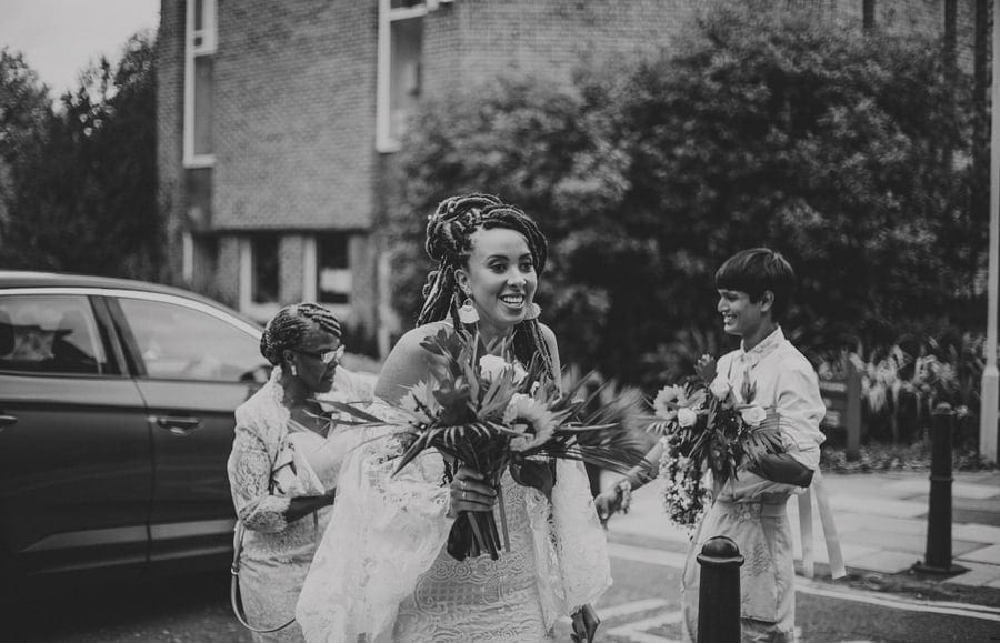 The bride walks towards friends and family