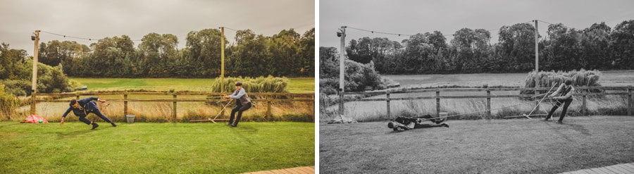 Wedding guests playing tug of war in the garden at Hadsham Farm