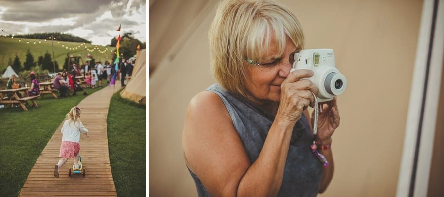 A wedding guest takes a photograph with a polaroid camera