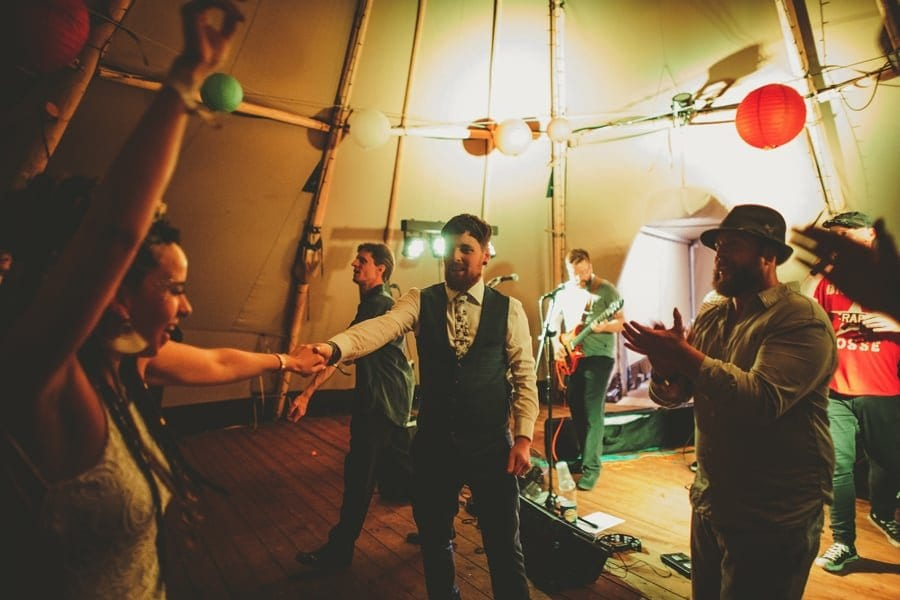 The bride and groom on the dancefloor in the tipi at Hadsham Farm