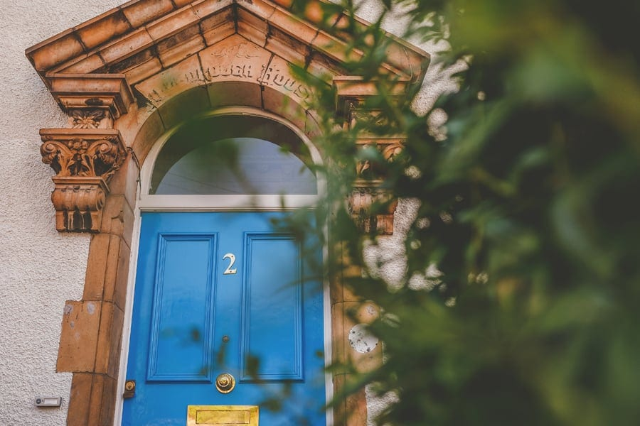 The blue front door of the bride and grooms house in Bristol