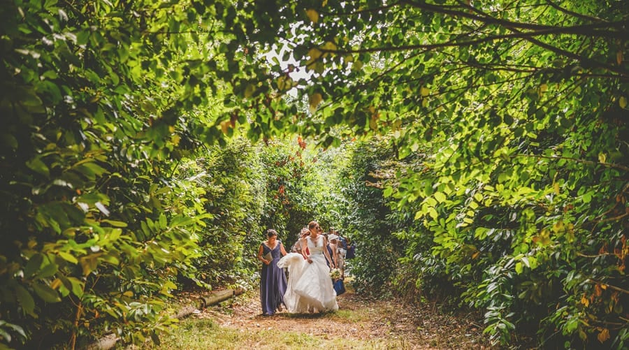 The bride walks through the woods with her bridesmaids towards Hanham Court