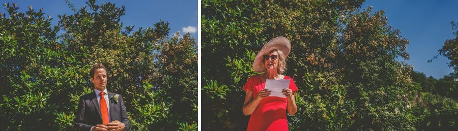 Wedding guests reads poems during the outdoor ceremony in the gardens at Hanham Court