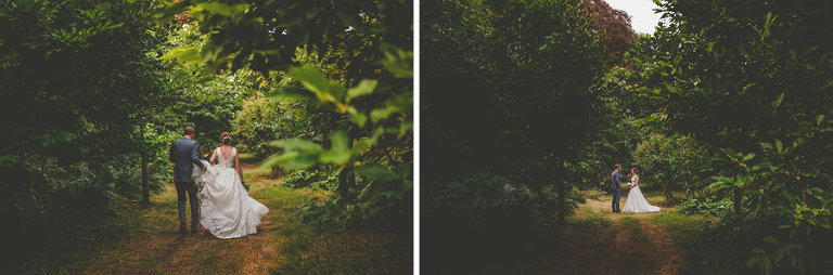 The bride and groom walk through the woods at Hanham Court