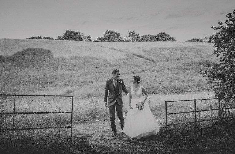 The bride and groom walk around the Estate at Hanham Court